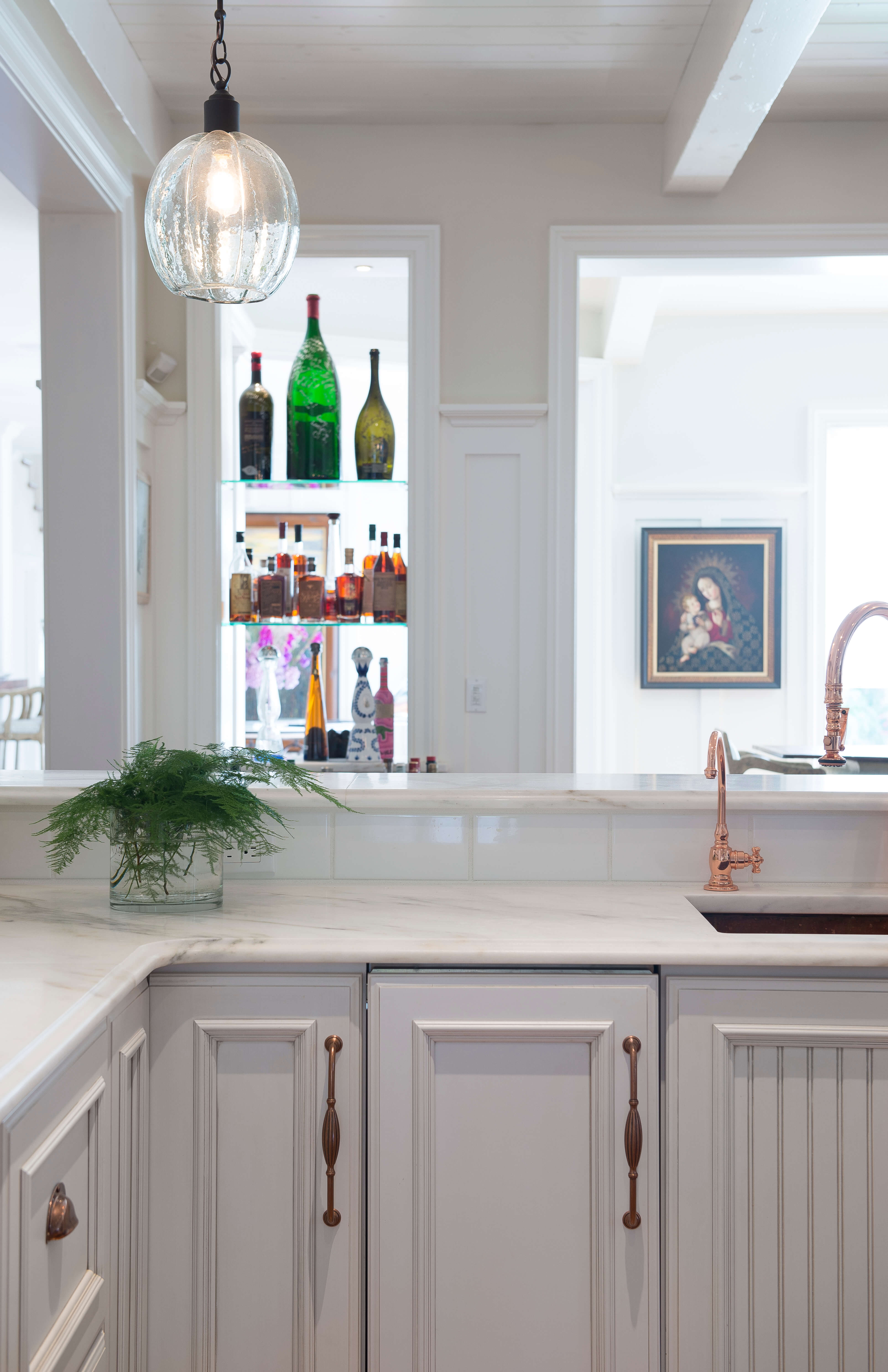 An ice maker is located to the left of the sink for convenience.
