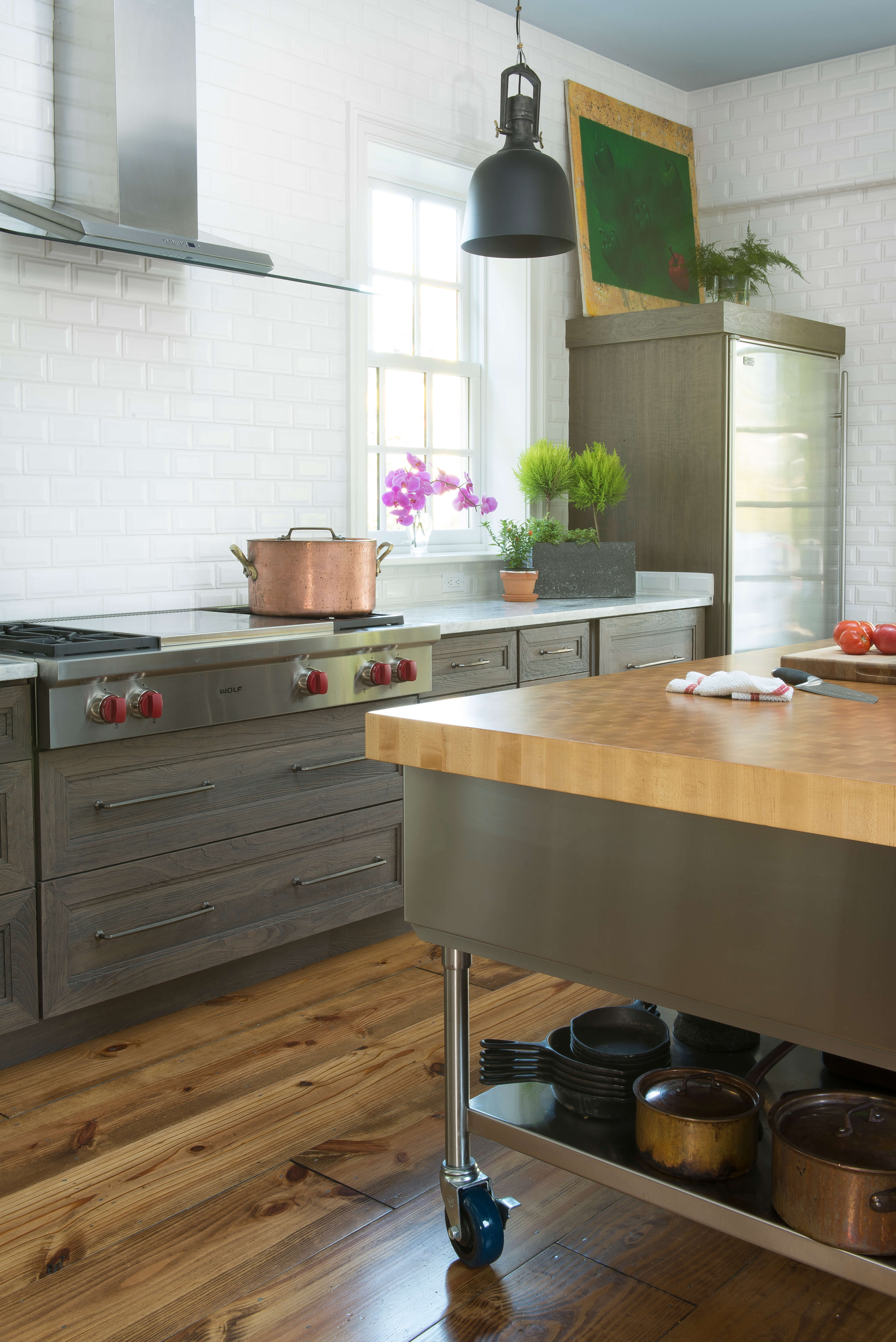 White subway tiles are used in both kitchens to tie the 2 designs together.