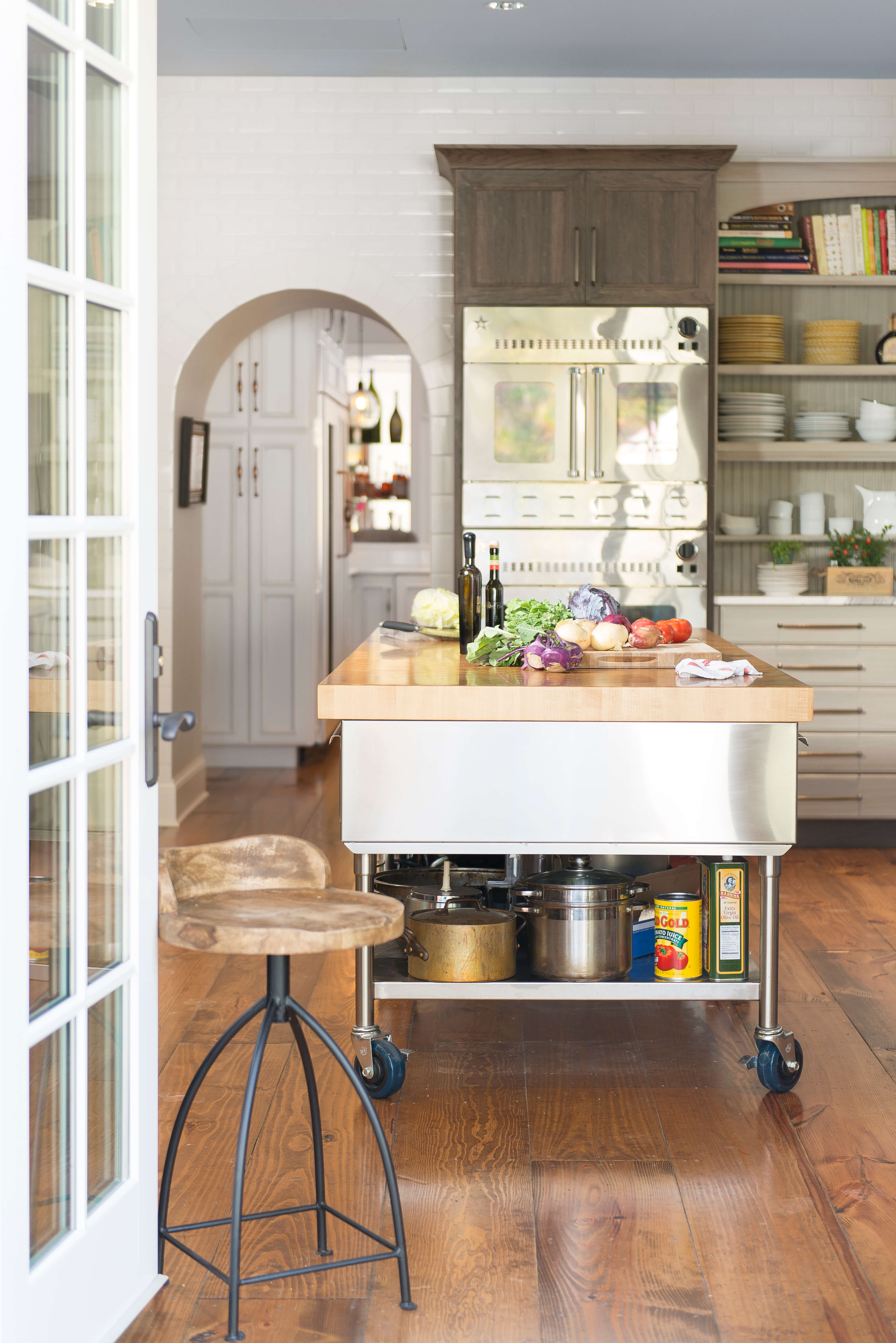 The garage door was replaced with French doors leading to the outdoor kitchen space.
