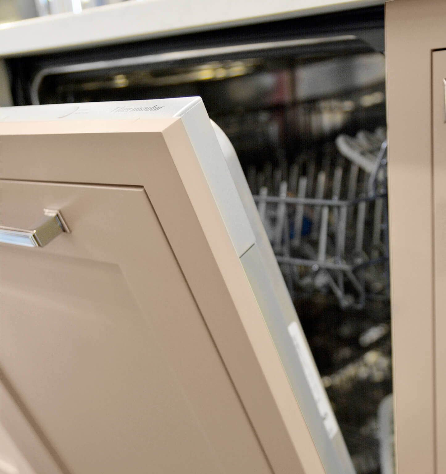 A dishwasher is hidden with a Dura Supreme cabinet appliance panel from Dura Supreme Cabinetry.