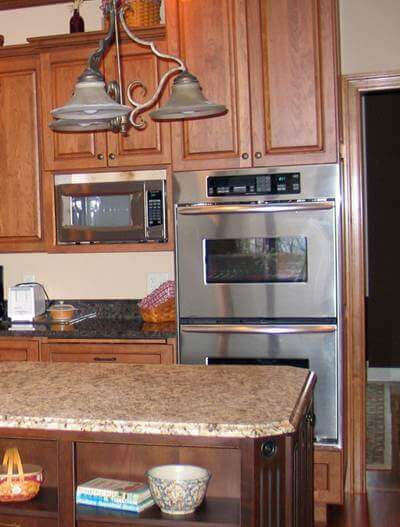 Remember to leave room between the cabinetry and architectural details such as the door casing to the right of the oven cabinet.