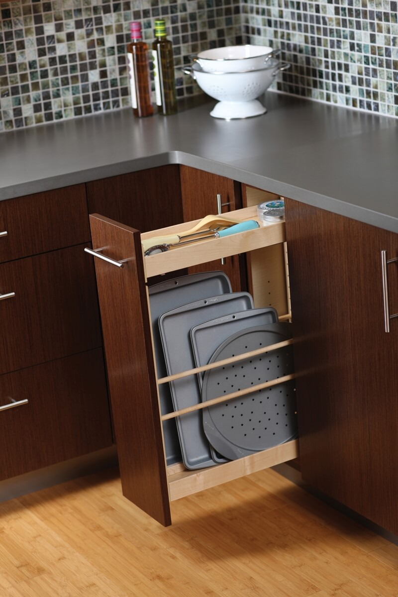 A Pull-Out Tray Cabinet from Dura Supreme offers practical and convenient use of space and works great for storing pans and cookie sheets in small spaces.