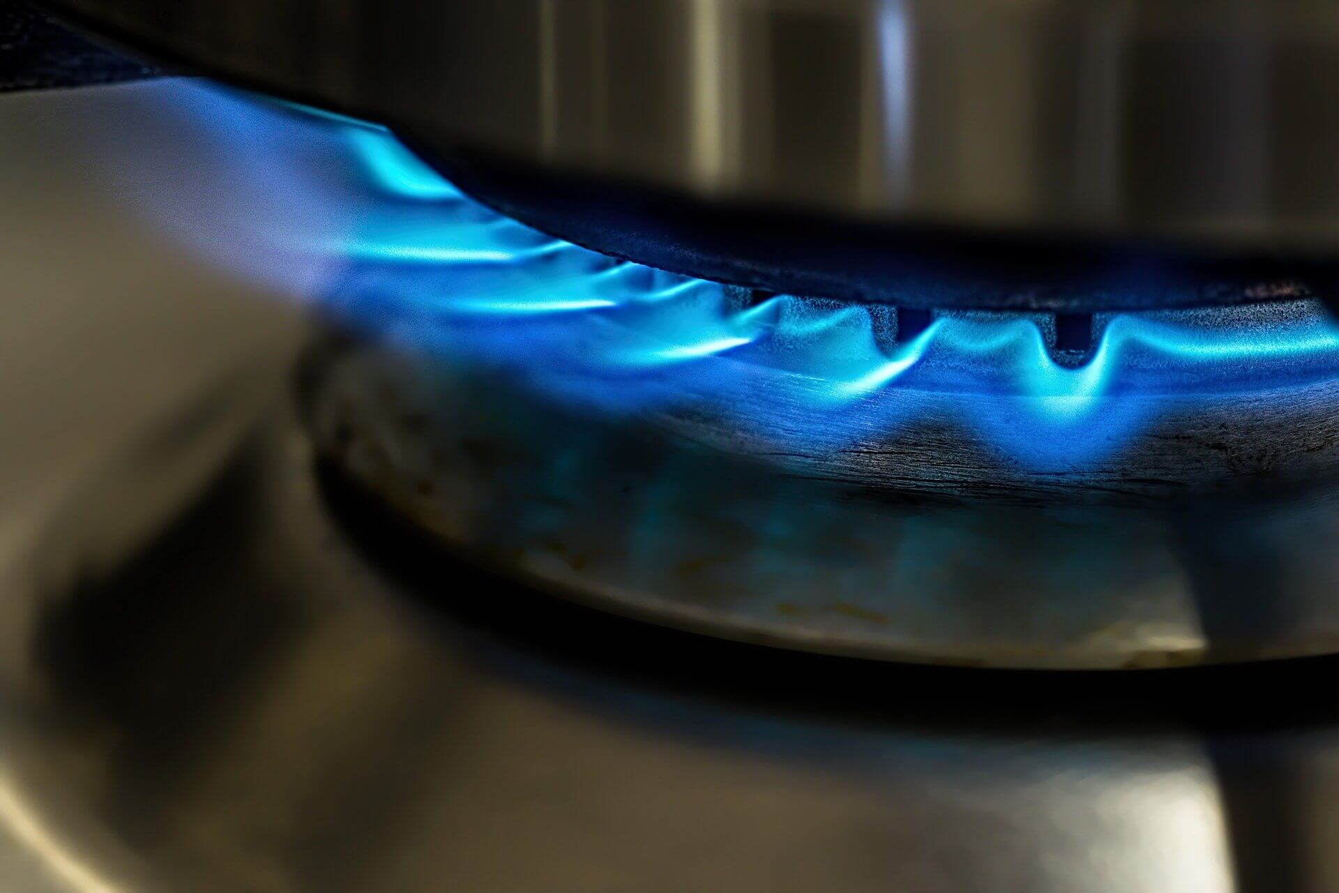 A close up of a gas burner on a stove top.
