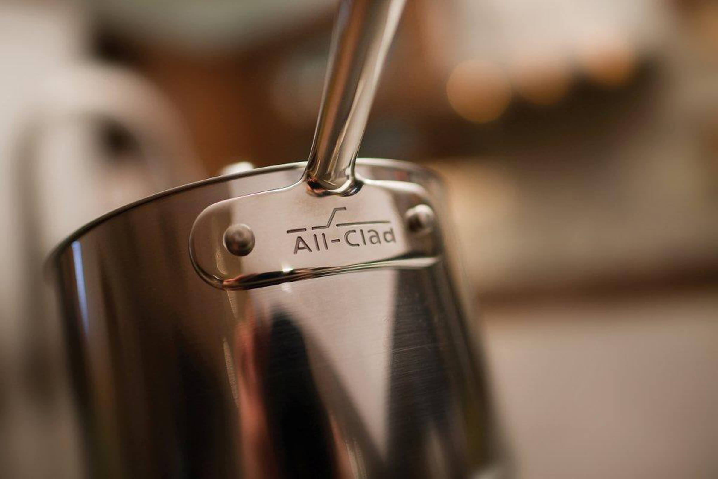 How to plan a kitchen remodel and new kitchen appliances. A close up photo of a stainless steel pot on a stove top of a remodeled kitchen.