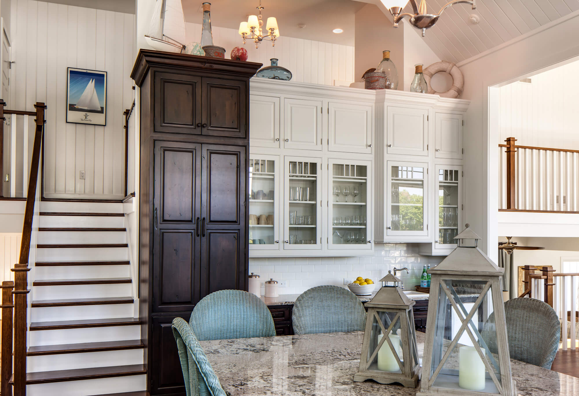 Dura Supreme Knotty Alder cabinets in dark Patina Stained finish. Design by Kim Hoegger of Kim Hoegger Home, Texas.