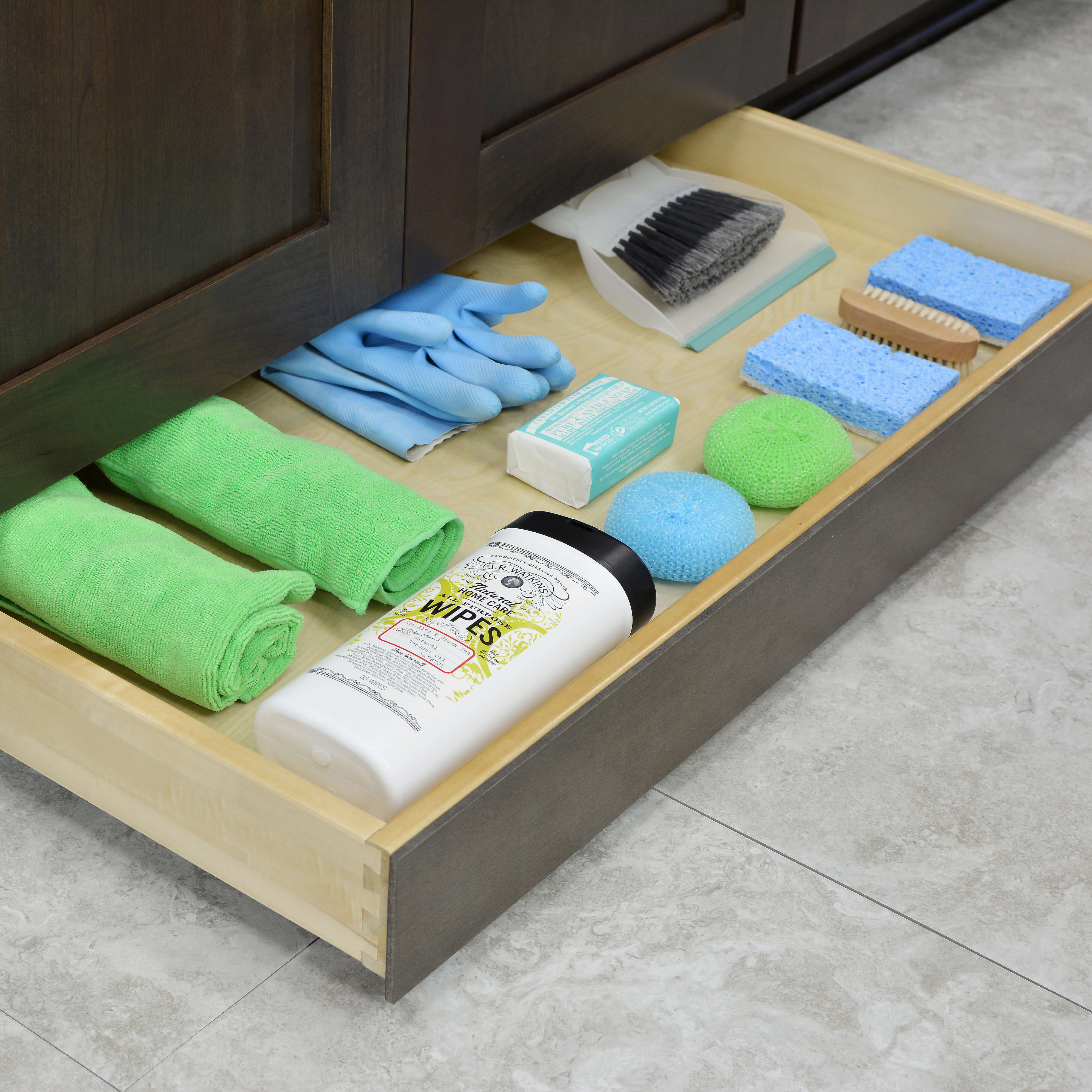 A toe kick drawer near an area that requires frequent cleaning, link at a kitchen island or near a kitchen sink can provide a space to store cleaning supplies close at hand.