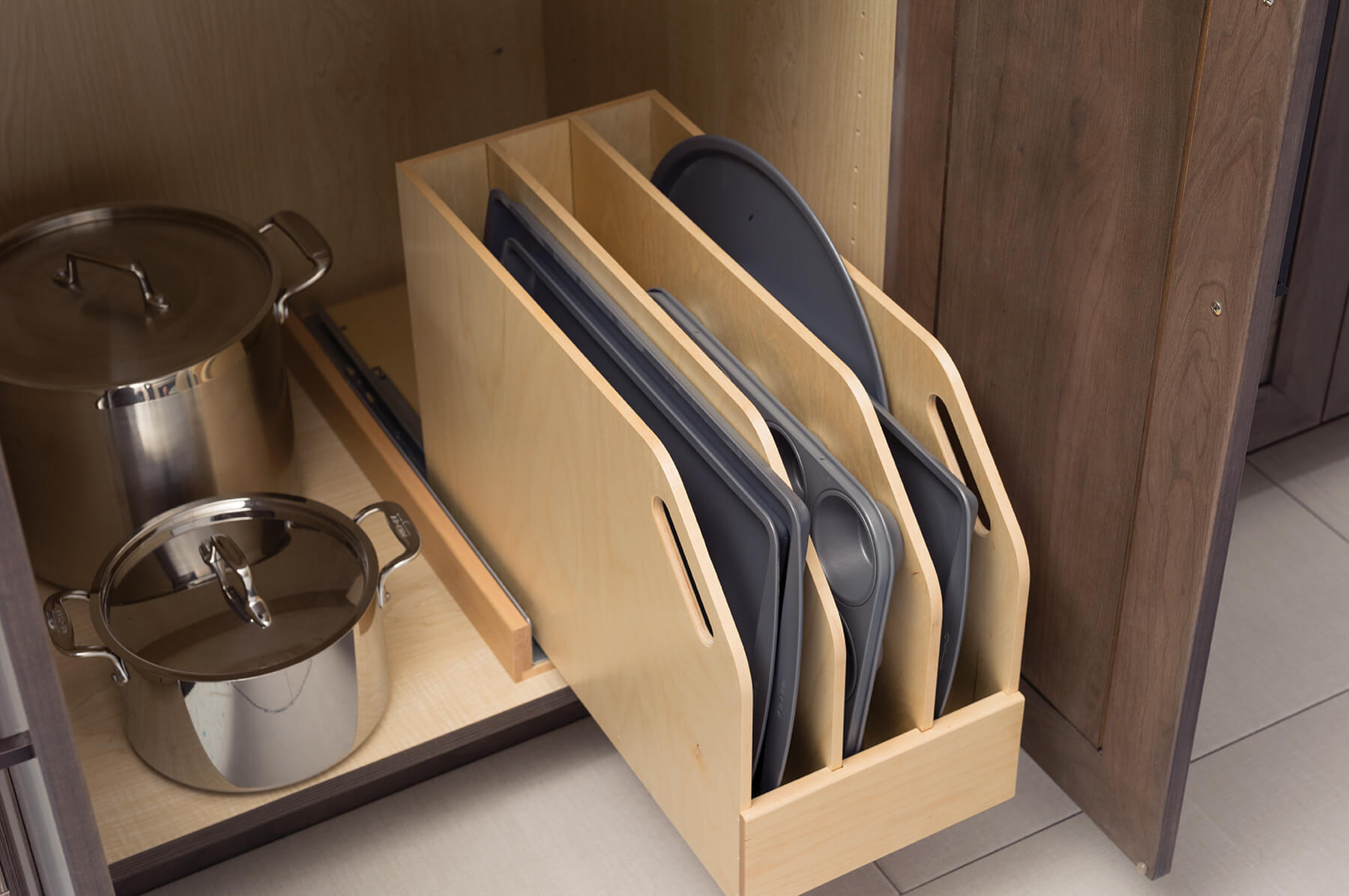 Trays, Pans, and cutting boards can be stored in a roll-out Tray Divider Pull-Out for practical and convenient use of space in a base cabinet.