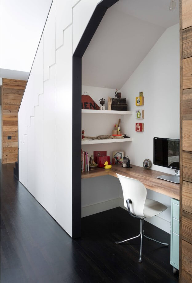 Desk under the stairs designed by By Hugh Jefferson Randolph Architects in Austin, TX