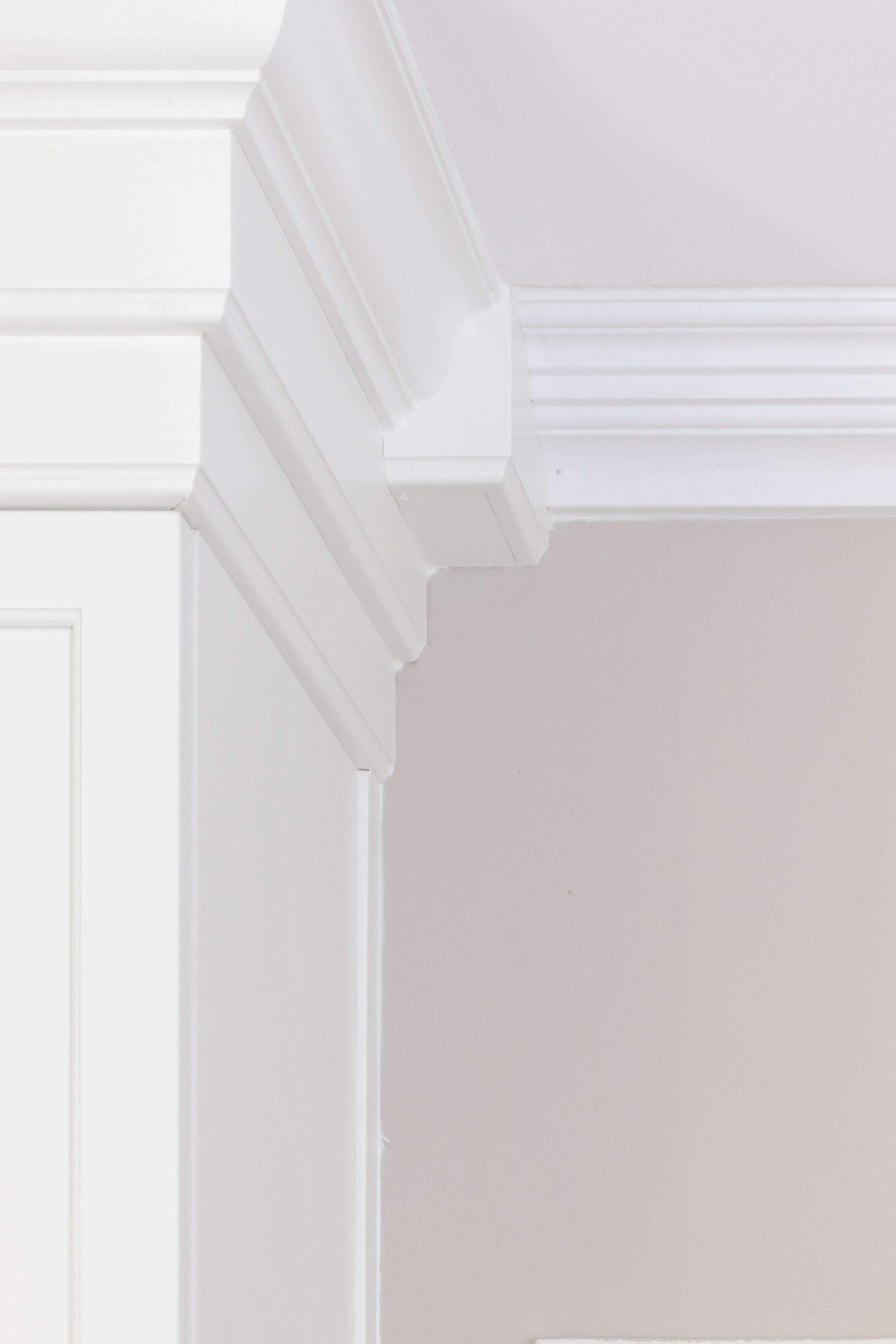 Triple Stack Crown Molding at the top of kitchen cabients from Dura Supreme Cabinetry