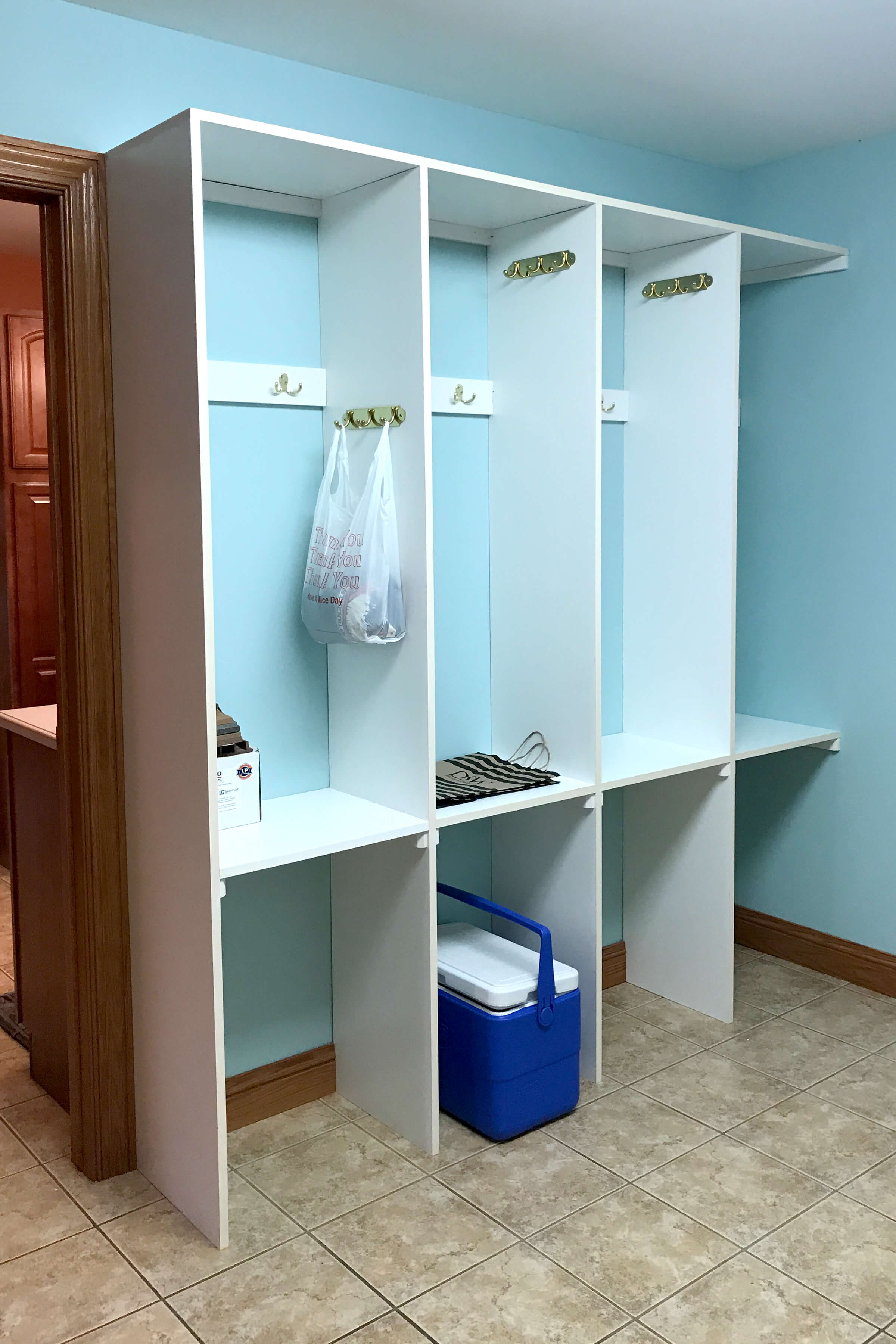 Before photo of the outdated entryway lockers